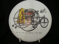 H183 - Souvenir of 1979 Milk Race - Enameled Cork Backed Teapot Stand